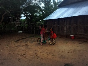 Children playing in the yard at our homestay