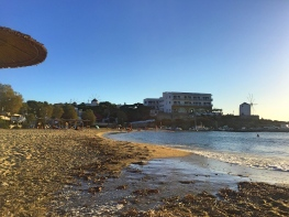 Beach along the main strip of Parikia.