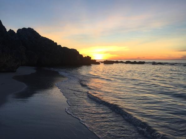 cave beach sunset